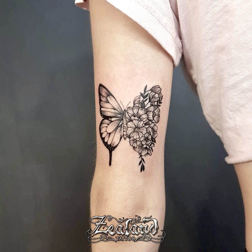 Delicate butterfly flowers tattoo