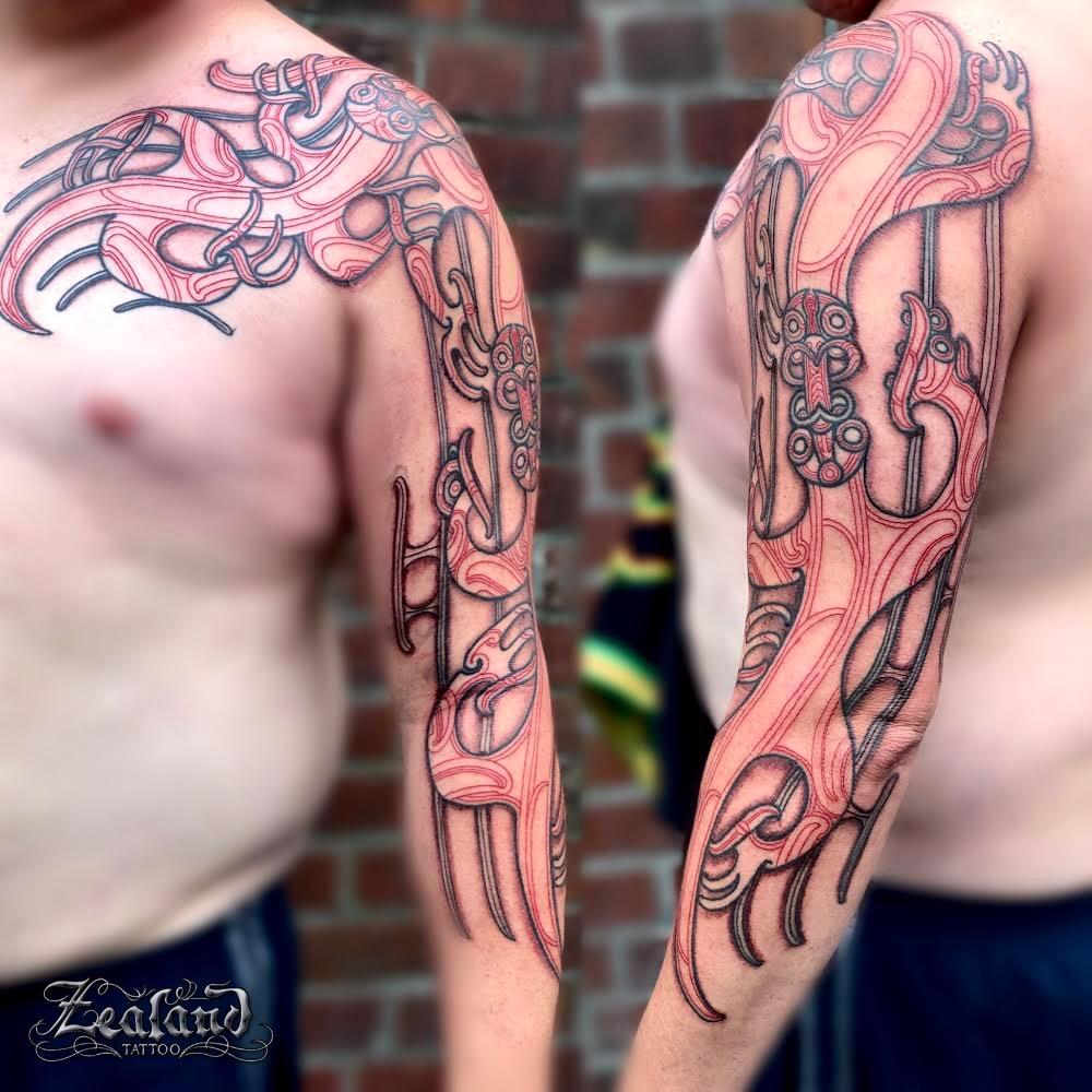 Kirituhi chest arm tattoo