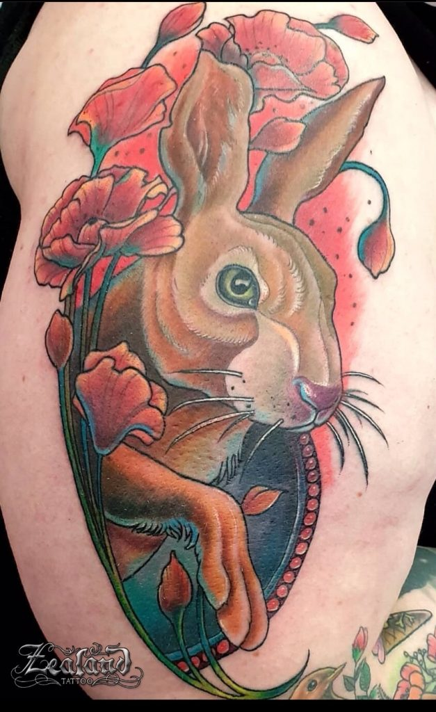 Full-colour rabbit outer arm tattoo